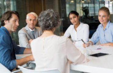 group coaching at conference table